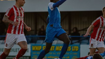 Suji Odelusi powers through on goal as Will Davies is brought down in the box, although Leiston's p