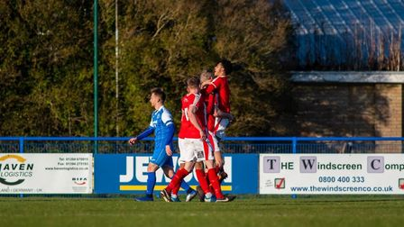 Stourbridge celebrate scoring what proved to be the only goal of the game ,at Leiston on Saturday.Pi
