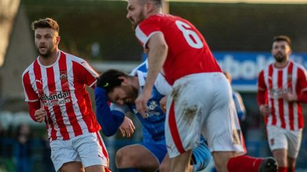 John Sands clashes heads with Stourbridge's Jamie Willets (No. 6) during Leiston's 1-0 home defeat.