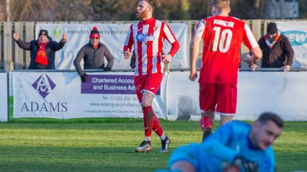Ollie Canfer (red, left) celebrates scoring the opening goal for the Seasiders against Romford. Pict