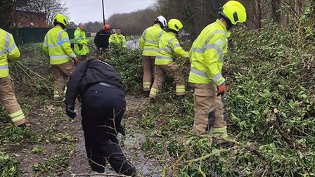 Workers help to clear the A142 after a tree blocked the road near Newmarket, Picture: SUFFOLK POLICE