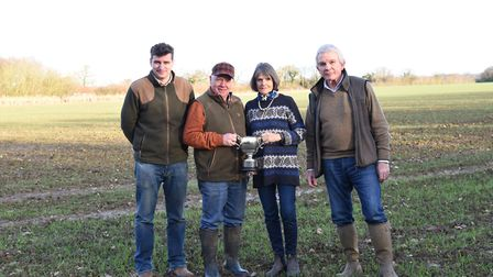 Contractors Joe and Philip Bloomfield alongside farm owners Belinda and David Grant at Fordley Hall