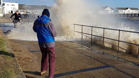 Dramatic photos show residents being hit by the waves. Picture: STEPHEN WOOLLEY @antiquechicgeek_of_