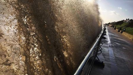 Waves batter the sea front at Southwold. Picture: NEIL DIDSBURY