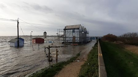 The beach huts at Brightlingsea partially submerged off the coast of Essex as a result of Storm Ciar