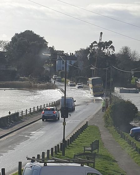 Point Clear Road, the only road in and out of Point Clear, has flooded at Mill Dam Lake Picture: MEL