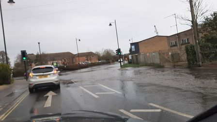 Quayside, a main road in Woodbridge, has been flooded and closed by police. Picture: FAYE BYE