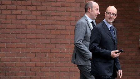 Pc Paul Brown (right with glasses) leaving an earlier hearing at Suffolk Magistrates' Court Picture