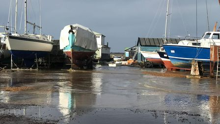 Water from the River Deben washed into Felixstowe Ferry boatyard Picture: Victoria Pertusa