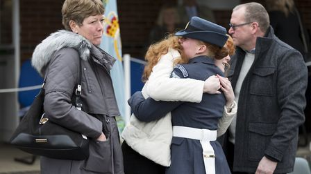 LAC Georgia Sandover celebrates with her family after the graduation ceremony at RAF Honington. Pict