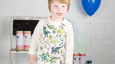 The colour-in dionsaur shirt from Selfie Clothing was spotted being sported by Saint West, son of Ka