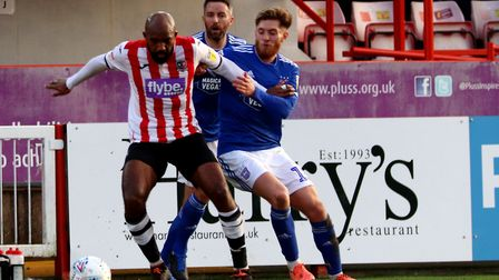 Teddy Bishop battles for the ball during Town's 2-1 defeat at Exeter City in the EFL Trophy Photo: R