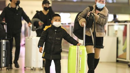 People in Wuhan are wearing masks to protect them from the virus. Picture: Chinatopix via AP