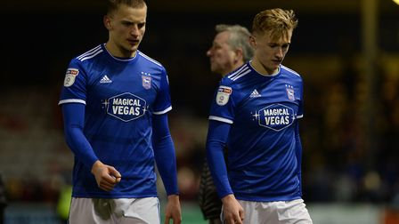 Luke Woolfenden and Flynn Downes leave the pitch after the 5-3 defeat at Lincoln City in December. P