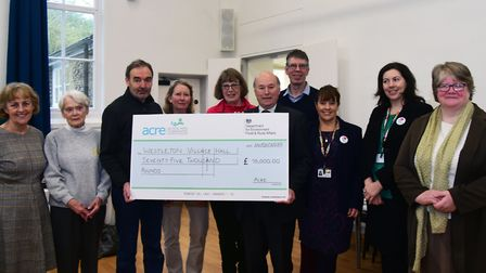 DEFRA minister Lord Gardiner gifted a �75,000 cheque from the government to help pay for the work wh