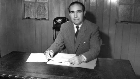 Alf Ramsey, who led Ipswich Town to the Division One Championship, in his tiny bare office in the fo