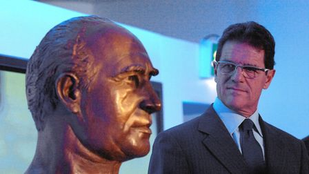 Former England manager Fabio Capello with a bust of Sir Alf Ramsey at Wembley Stadium. Picture: PA