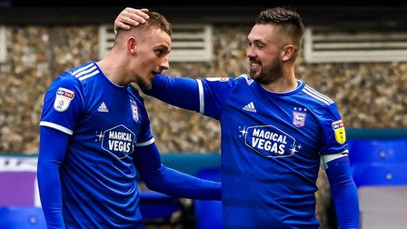 Luke Woolfenden is congratulated by skipper Luke Chambers after scoring to give Town a 1-0 lead late