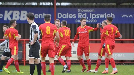 Needham Market players, celebrating a goal against St Ives in December, are hoping to make it three