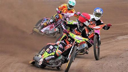 Danny Ayres in red in his Mildenhall days, team rides with Drew Kemp in blue keeping Leon Flint in 3