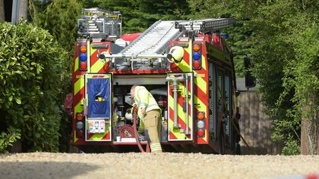 Emergency services at the scene following the incident at the bunglalow in Lidgate Picture: SARAH L