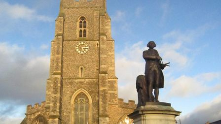 St Peter's church in Sudbury with the statue of Thomas Gainsborough in front. Picture: ROSS BENTLEY