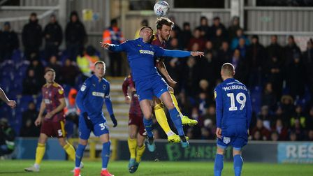 Emyr Huws challenges at AFC Wimbledon Picture Pagepix