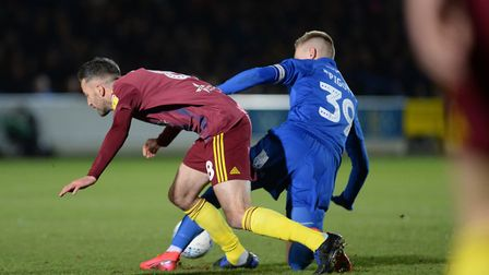 Cole Skuse under pressure at AFC Wimbledon Picture Pagepix