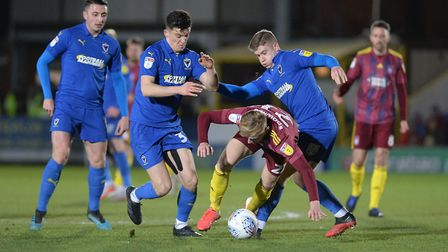 Flynn Downes under pressure at AFC Wimbledon Picture Pagepix