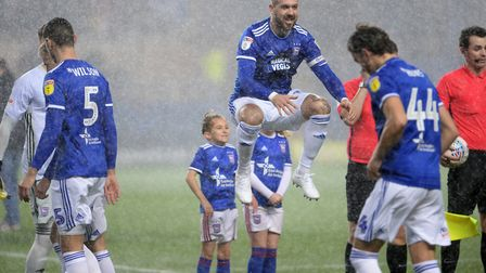 Luke Chambers relishes the heavy rain at Oxford United Picture Pagepix