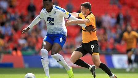 Tranmere Rovers defender' Manny Monthe (left) has been linked to Portsmouth. Photo: PA