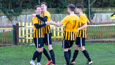 Stowmarket Town players celebrate one of their goals during Saturday's 7-1 demolition of Ely City. P