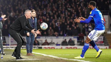 Town manager Paul Lambert throws the ball to Janoi Donacien ahead of a Town throw in as he tries to