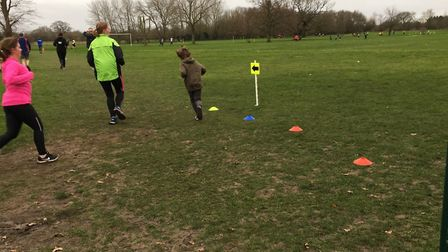 Runners keep their balance on the wet grass at the Soham Village College parkrun. Picture: CARL MARS