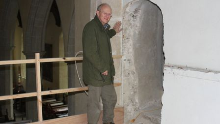 Malcolm Currie at the newly opened up doorway in Hitcham church tower PICTURE: Nicola Currie
