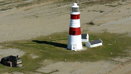 The Coastguard Station earmarked for demolition can be seen to the left of Orfordness Lighthouse Pic
