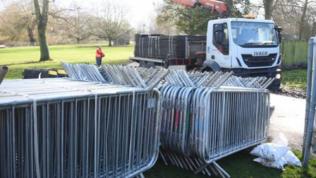 Workmen unload a lorry ready for the work to remove the old tennis courts at Abbey Gardens to start