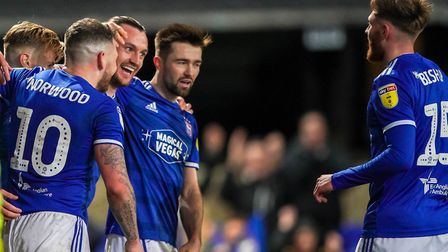 Will Keane celebrates with teammates after scoring Town's fourth in the 4-1 victory over Accrington