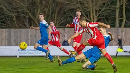 Joseph Yaxley has a rare shot on goal for Felixstowe & Walton, during their 4-1 defeat at Ram Meadow