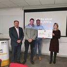 Tom James, second from right, receives his prize from Peter Basford, left, and local prize fund dono