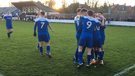 Bury Town players celebrate Cemal Ramadan's successful penalty, which put the hosts 2-0 up just befo