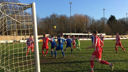 The set piece that led to Bury's opening goal, Keeper Jack Spurling is out of position as Bury strik