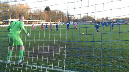 Bury striker Cemal Ramadan steps up to convert a penalty, past keeper Jack Spurling. Picture: CARL M