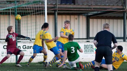 Soham's Camerson Watson (green No. 3) fires home the only goal of the game in the 1-0 defeat of AFC