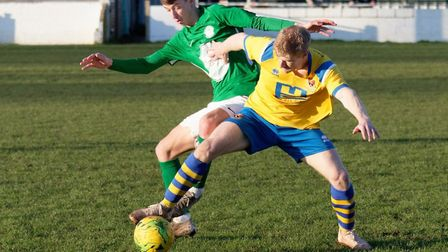 Soham's Ally Conway and AFC Sudbury's Kyle Cassell contest possession. Picture: PAUL VOLLER