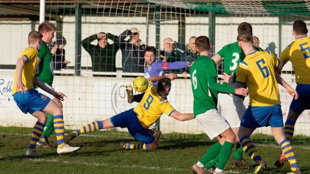 A loose ball bobbles around in Soham's penalty area, one of several missed chances for AFC Sudbury.