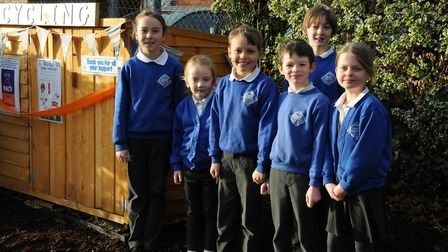 Pupils at the school with the new recycling centre Picture: BEDFIELD CEVC PRIMARY SCHOOL