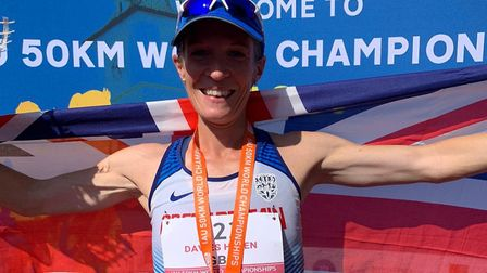 Helen Davies celebrates finishing second at the 50K World Championships, in Brasov, Romania, at the