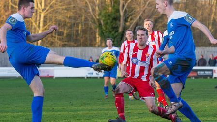 Bury Town defenders Alex Henderson, left, and Joe White, clear the ball away with Seasiders' Jordy M