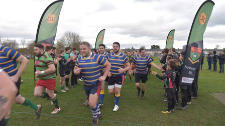 Players enter the field ahead of the match in memory of Private Robert Hayes Picture: SONYA DUNCAN